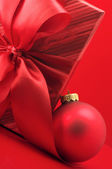 Red gift and Christmas decoration — Stock Photo