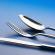 Silverware on blue — Stockfoto