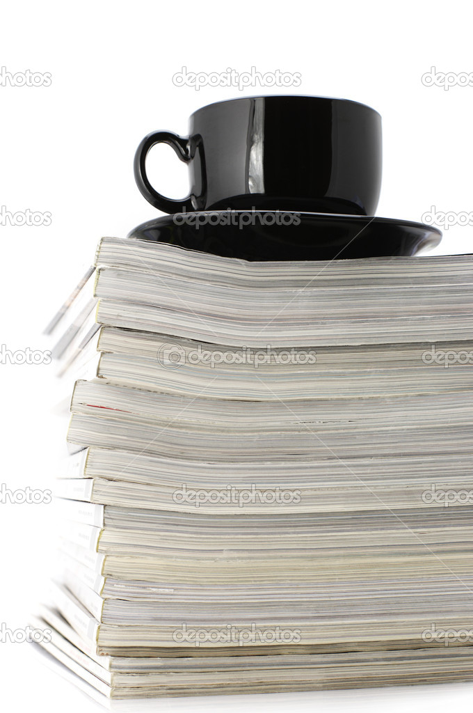 Stack of magazines and black cup of coffee isolated on white background. — Stock Photo #2950445