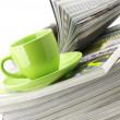 Magazines and coffee cup — Stock Photo