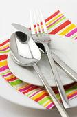Silverware on plate — Stock Photo