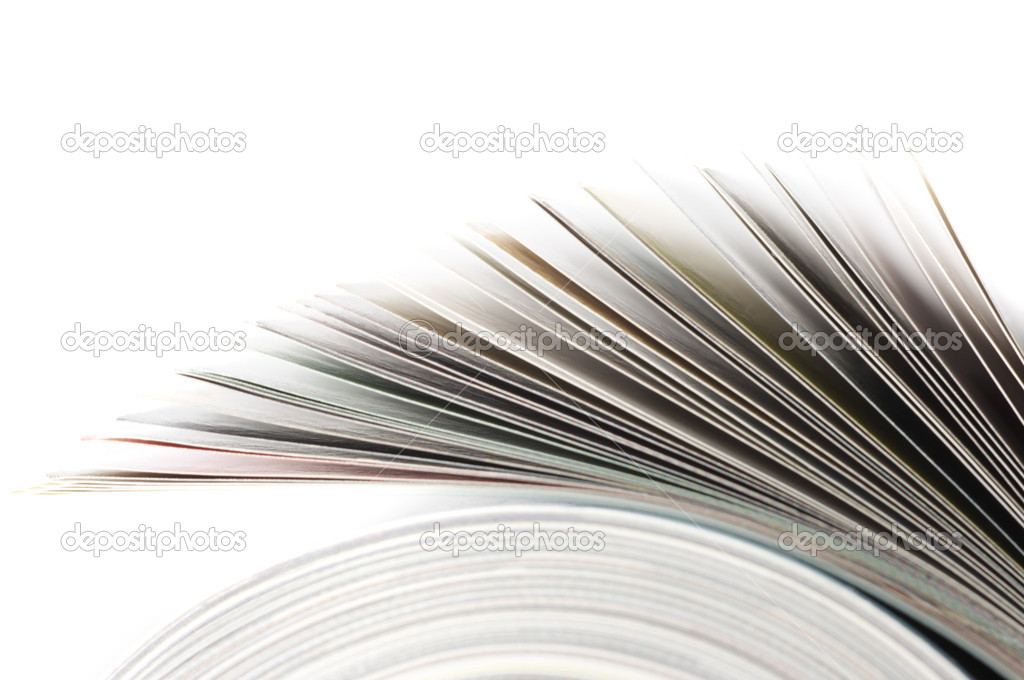 Close-up of rolled magazine isolated on white background. — Photo #2968620