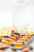 Pills and water — Stock Photo