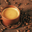 Stock Photo: Cup of coffee and coffee beans