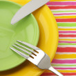 Stock Photo: Plates, fork and knife