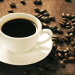 Vintage cup of coffee and beans - Stock Photo