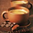 Cups of coffee and chocolate - Stock Photo