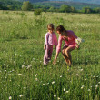 Mother and daughter on meadow - Stockfoto