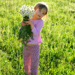 Little girl with flowers - 图库照片