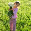 Little girl with flowers - Foto Stock