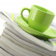 Stock Photo: Magazines and coffee cup