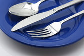 Silverware on plate — Stock Photo