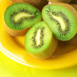 Royalty-Free Stock Photo: Heap of kiwi on yellow