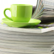 Magazines and coffee cup — Stock Photo #3321670