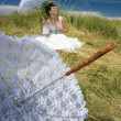 Bride and lace umbrella - Zdjęcie stockowe