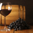 Red wine, grape and barrel - Stock Photo