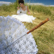 Bride and lace umbrella - Stock Photo