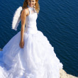 Bride on rock — Stock Photo
