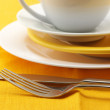 Yellow and white dishware — Stock Photo