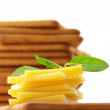 Crackers with cheese and basil — Stock Photo #3490165