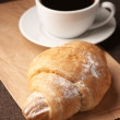 Croissant and black coffee — Stockfoto