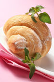 Croissant on plate close-up — Stock Photo