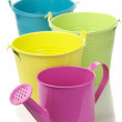 Colorful buckets and watering can — Stock Photo