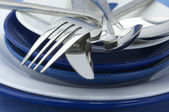 Silverware on plates — Stock Photo
