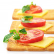 Royalty-Free Stock Photo: Crackers with cheese, tomato and basil