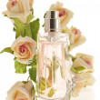 Bottle of perfume with roses - Stock Photo