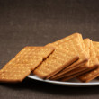 Crackers in plate - Stock Photo