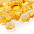Vitamin and fish oil capsules - Stock Photo