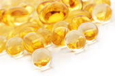 Vitamin and fish oil capsules — Stock Photo
