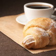 Croissant and black coffee — 图库照片