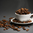 Coffee beans in cup - Stock Photo