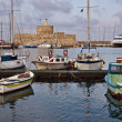 Mandraki Harbor And Lighthouse - Stock Photo