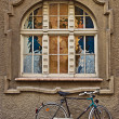Figured window and bicycle, Salzburg — Stock Photo