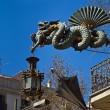 Dragon on modern house corner — Stock Photo
