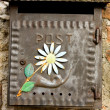 Stock Photo: Rustic metal box with flower