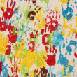 Handprints in different colors in a mural. — Stock Photo