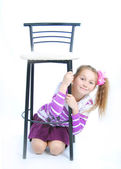 The girl under a chair — Stock Photo