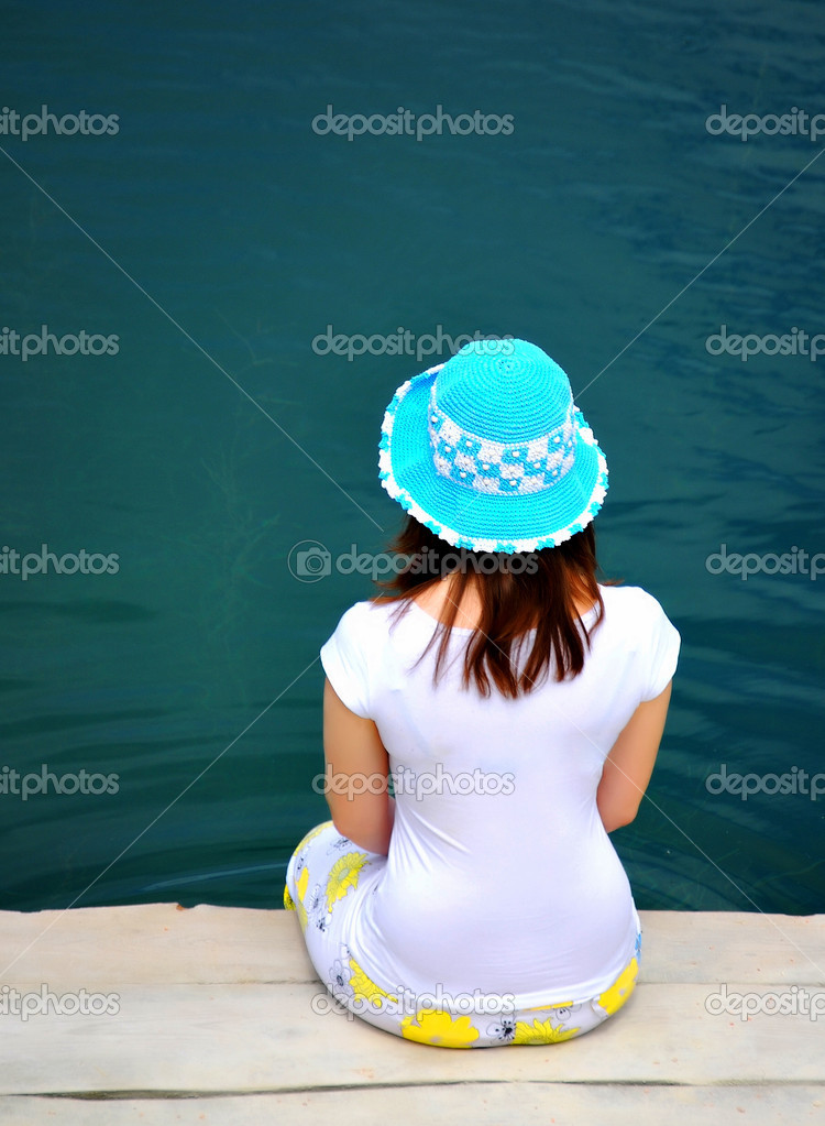 Young girl dabble in water by lake  Stock Photo #3622839