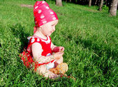 Baby sitting on the grass — Stock Photo