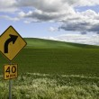 Stock Photo: Right turn hills and clouds