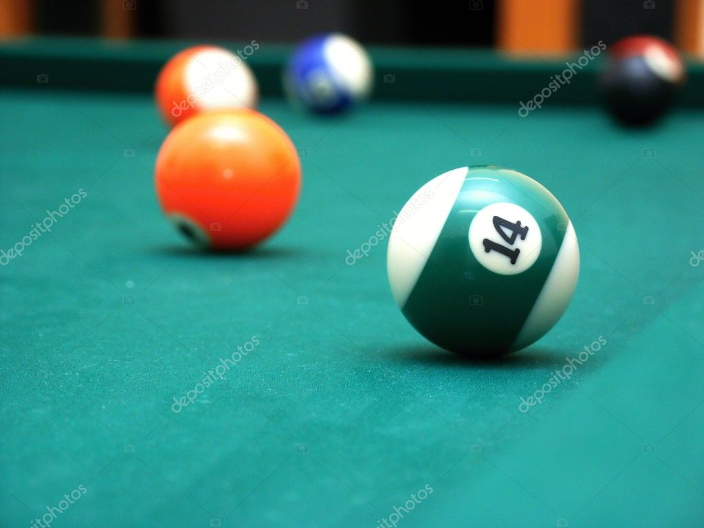 Billiard balls on green table - orange and half green — Stock Photo #2799943