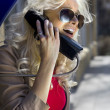 Blonde with phone handset — Stock Photo #2992251