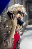 Blonde with phone handset — Stock Photo