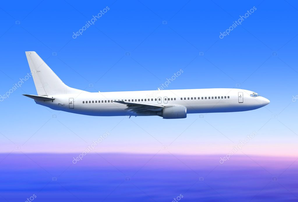 White passenger airplane in the blue sky landing away  Stock Photo #2991510