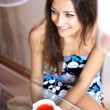 Girl with white cup of tea — Stock Photo