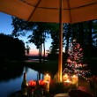 Stock Photo: Romantic Candlelit Dinner by the Lake
